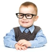 14589888-portrait-of-a-cute-little-boy-wearing-glasses-isolated-over-white.jpg