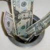 money_down_drain.jpg